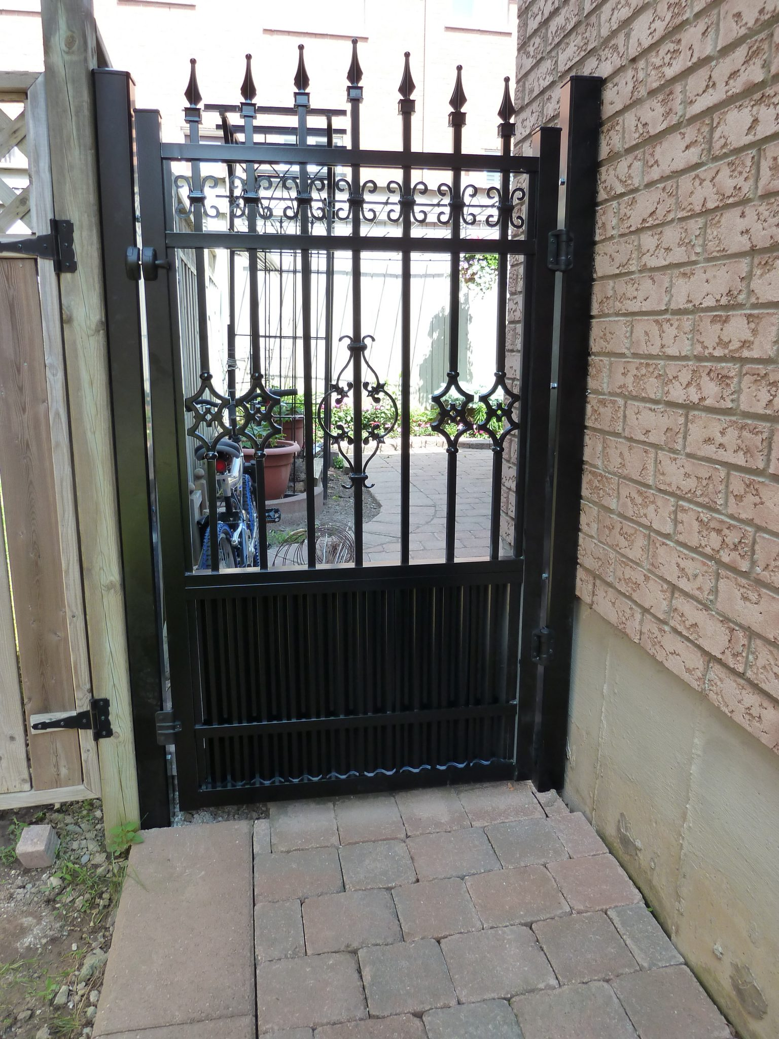 Black yard gate.