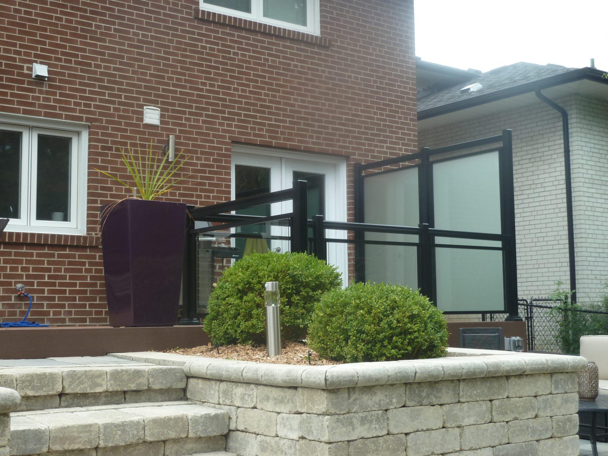 Glass railings to widen backyard patio