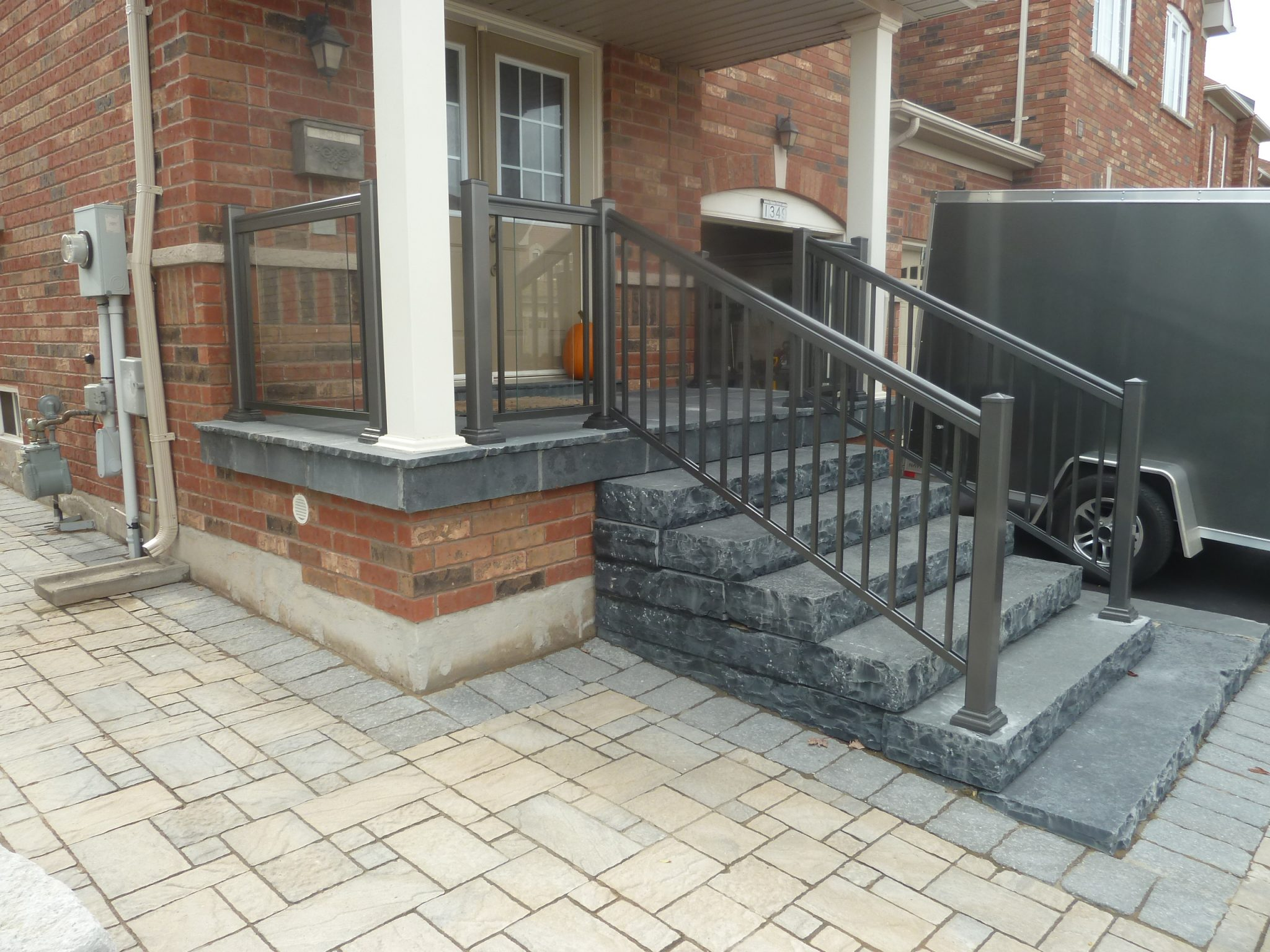 Natural stone steps with aluminum railing