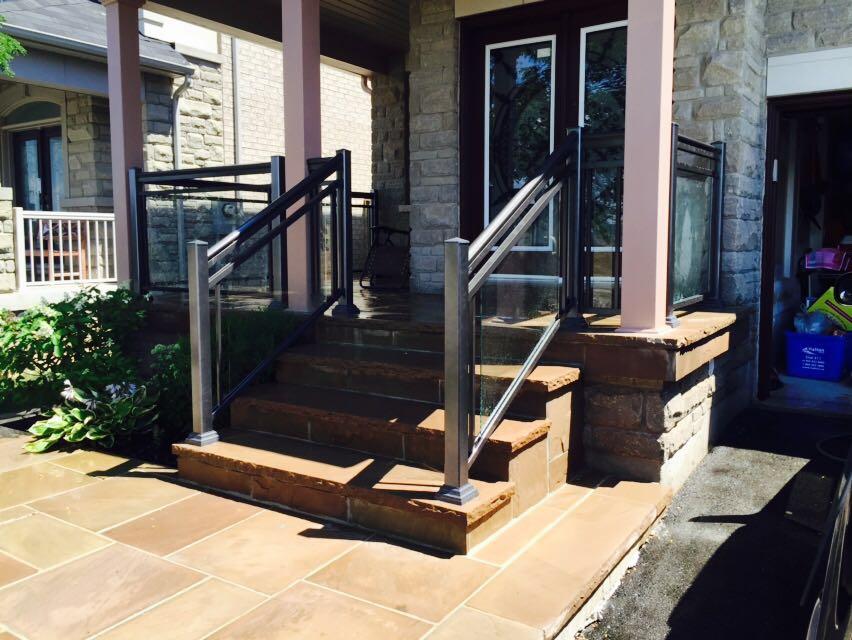 Stone steps under glass railings.