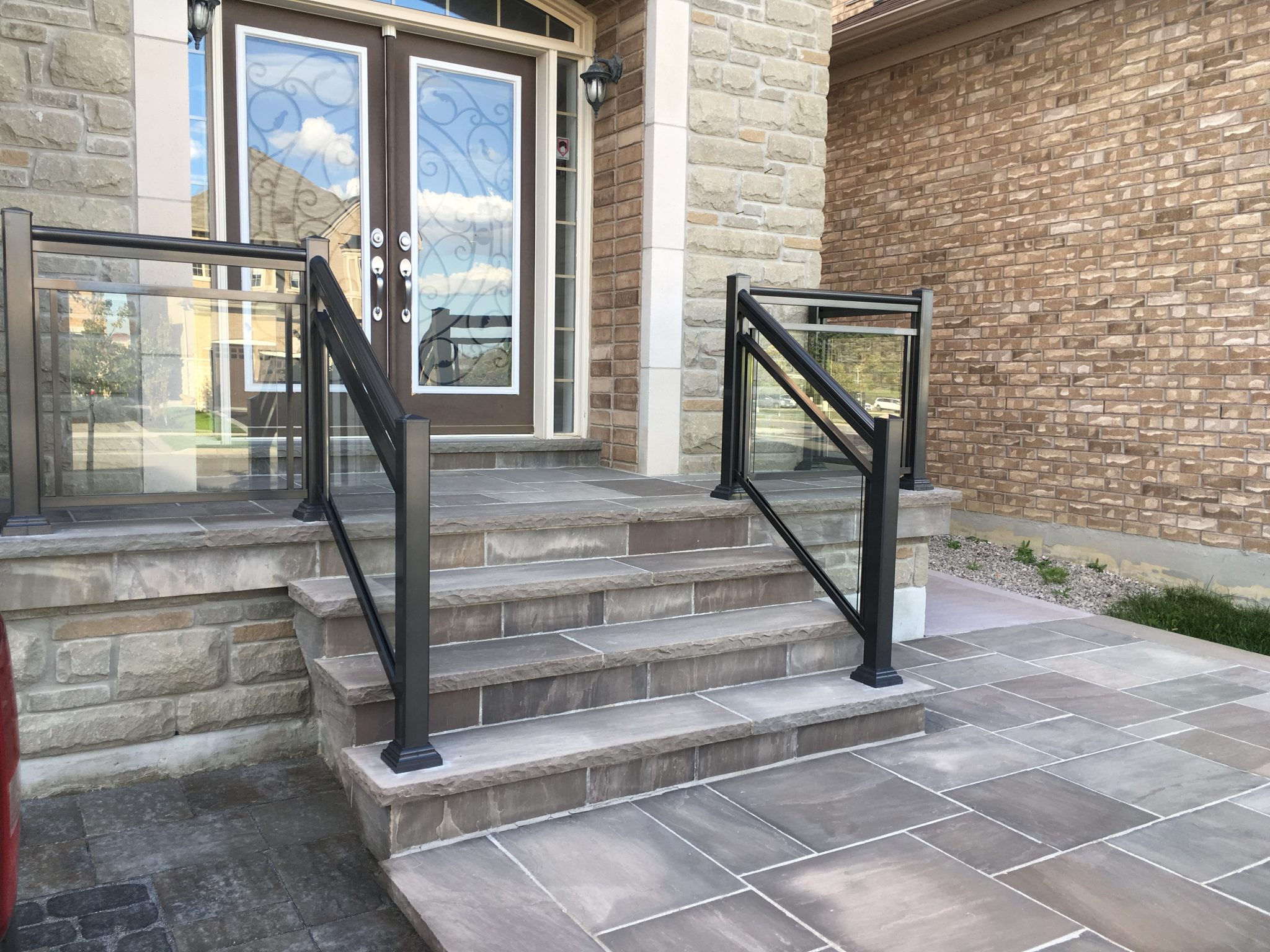 Front steps with glass railings