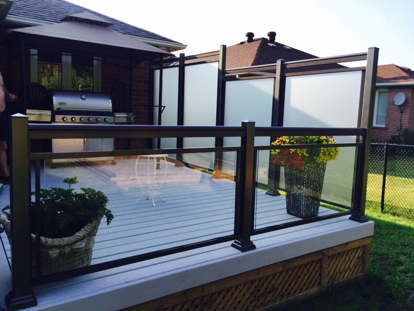 Glass wall and glass railings on wood deck