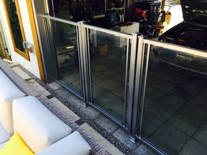 Garage encased with glass wall.