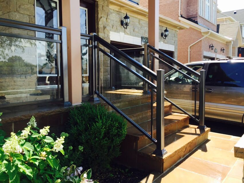 Front steps with glass railing.