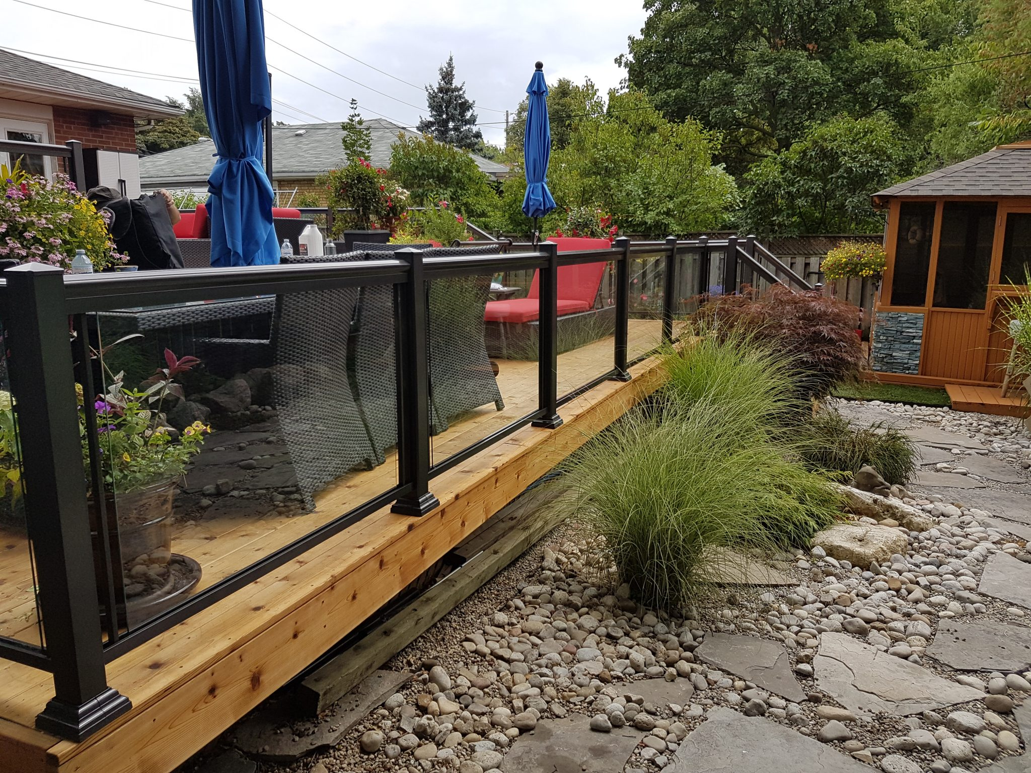 Wooden deck with glass rails